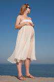 Expectant mother at the sea Stock Photography