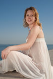 Expectant mother at the sea royalty free stock image