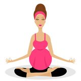 An expectant mother sits in the pose of lotus Royalty Free Stock Photo