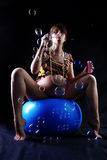 Expectant mother with soap bubbles Stock Images