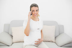 Expectant pregnant woman phoning with her smartphone Royalty Free Stock Images