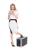 Expectant young woman with a tablet PC. And with a suitcase royalty free stock image