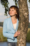 Expectation. Portrait of young woman near the birch Royalty Free Stock Image