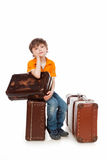 Expectation. The boy sits on a suitcase. Expectation royalty free stock images