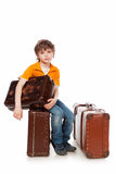 Expectation. The boy sits on a suitcase. Expectation royalty free stock photography