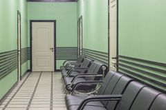 Expectation zone. A corridor with sofas. Waiting room. A zone for the expecting people. A corridor with sofas and doors Royalty Free Stock Images