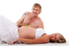 Expecting Couple Relaxing - Isolated Stock Photos