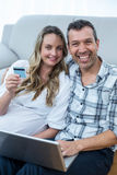 Expecting couple sitting on floor Royalty Free Stock Photo