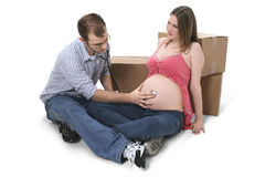 Expecting Couple Sitting Near Moving Boxes Stock Photography