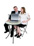 Expecting Couple Sitting at Table with Computer Stock Photos