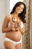 Expecting Mother Holding Belly Stock Photos