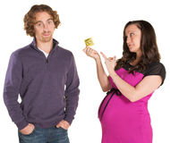 Expecting Parents with Condom Stock Photography