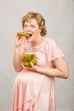 Expecting Woman with Pickle Royalty Free Stock Images