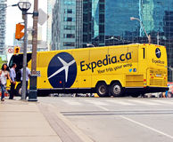 Expedia. Advertisement for Expedia Canada,an Internet-based travel website company,on a bus,in a street in Toronto Royalty Free Stock Photos