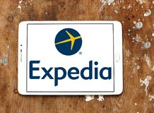 Expedia logo. Lgoo of Expedia on samsung tablet on wooden background. Expedia.com is a travel website owned by Expedia Inc. The website can be used to book Stock Photo
