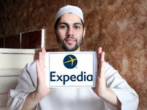 Expedia logo. Lgoo of Expedia on samsung tablet holded by arab muslim man. Expedia.com is a travel website owned by Expedia Inc. The website can be used to book Stock Photography