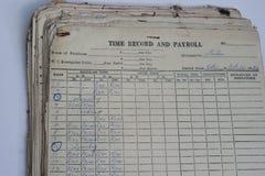 Expediente y nómina de pago de antaño Foto de archivo libre de regalías