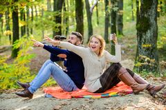 Expedition concept. couple in love relax in autumn forest with tea or coffee. Family picnic. camping and hiking. Surprised girl drink mulled wine. bearded men stock photography