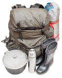 Expedition equipment isolated on white background. Set of expedition equipment with backpack, tent, pot, rubber boots, thermos, gas burner isolated on white Royalty Free Stock Image