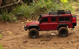 Expedition Land Rover Defender off-road vehicle. Offroad trip Land Rover Defender expedition radio controlled car royalty free stock photos
