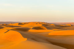 Expedition Omani desert. Sultanate Oman - Endless expanse featuring the fascinating sand and gravel deserts - a varied rhythm of white beaches and steep cliffs Stock Images