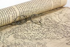 An expedition in preparation. Ancient map of the 19th century and glasses Stock Images