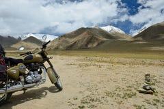 Expedition to the cultic Royal Enfield motorbike along roadless tracts Karakoram mountains. TSO KAR, JAMMU AND KASHMIR, INDIA - 06 JULY 2017: Motorbike Royal Royalty Free Stock Photography