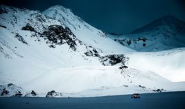 Expedition to the North Pole. Big powerful jeep in the snowy, majestic great mountaing, amazing winter landscape, active extreme life, Iceland stock images