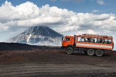 Expedition truck on mountain road on background volcanoes Royalty Free Stock Photography