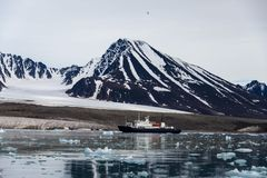 Arctic landscape in Svalbard with expedition vessel. Arctic landscape in Svalbard with glacier in summer time with sea and reflection stock photos