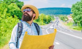 Expeditor backpacker map look direction travelling. Around world expedition. Map helps find right direction if get lost. Where should I go. Expeditor looking royalty free stock photos