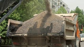 Expendable Materials in the Truck Loaded. Special equipment removes old asphalt road and the resulting waste is loaded into a truck stock video footage