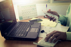Expenses calculation by a man on office desk Royalty Free Stock Image