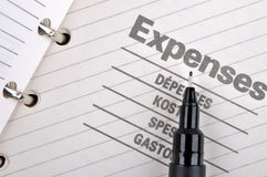 Expenses record and black pen Stock Images