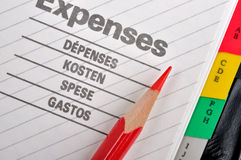 Expenses record and red pencil Stock Photo