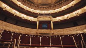 Expensive balcony in concert hall, vacant chairs rows, red draipings stock video