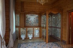 Expensive bathroom in a rich house. Women`s bathroom, trimmed and decorated with expensive wood: toilet, bidet and shower Stock Photography