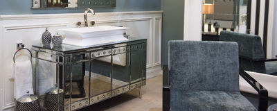 Expensive Bathroom Sink and Mirrored Cabinet. With Luxurious Accessories and High-End Decor Royalty Free Stock Photo