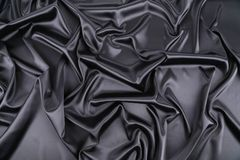 Expensive black silk background. Royalty Free Stock Photo
