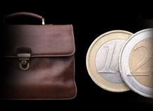 Expensive brown leather briefcase with money. Royalty Free Stock Image