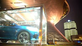 Expensive car standing in automobile showroom, business district, evening time. Stock footage stock video