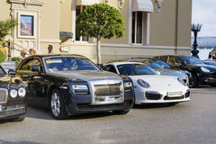 Expensive  cars on the street Royalty Free Stock Photos