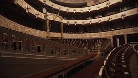 Expensive concert empty hall, red drapings, balcony with gold decorations stock video