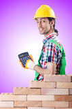 The expensive construction concept with builder Stock Photography