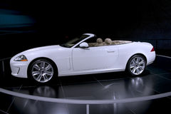 Expensive Convertible. This is an expensive white convertible with a tan interior on display at the auto show with the top down Royalty Free Stock Photography