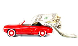 Red car with money Royalty Free Stock Photo