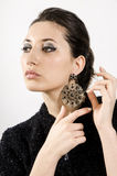 Expensive earrings. Portrait of beautiful woman with beautiful make-up and expensive earrings Royalty Free Stock Photo