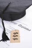 Expensive education. Concept of expensive education that diploma with tassel and price tag Stock Image