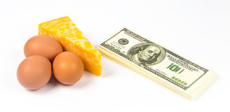 Expensive eggs, cheese and dollars Stock Images