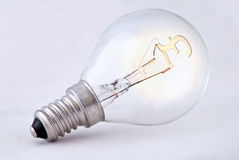 Expensive Electricity. Light bulb with the pound sterling sign signifying the rising cost of power Stock Photography